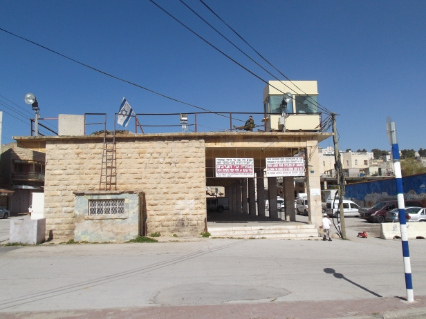 Hebron: Israeli checkpoints, lookouts, soldiers and propaganda are dotted throughout the so called settlements.