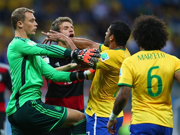 Brasilian and German players squabbling over another disputed goal