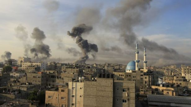 Smouldering buildings in Gaza