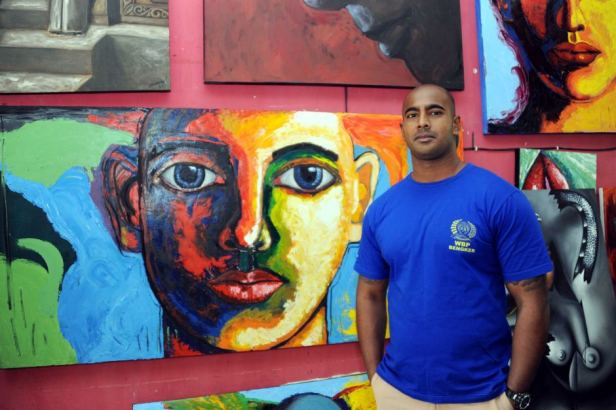 Myuran Sukumaran with some of his paintings
