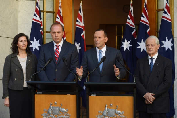 (L-R) Senator Concetta Fierravanti-Wells, Immigration minister Peter Dutton, Prime Minister Tony Abbott and Philip Ruddock speak during a press conference at Parliament House in Canberra, Tuesday, May 26, 2015.  (AAP Image/Lukas Coch)