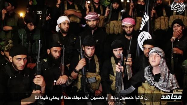 Australian Abdullah Emir and others in an ISIS video
