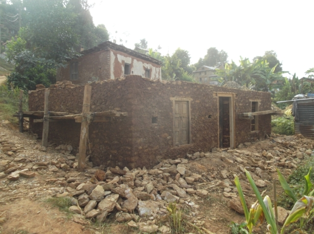 A house being rebuilt in Jwentar