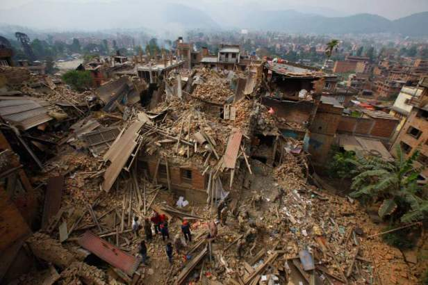 Rescue workers remove debris as they search for victims of earthquake in Bhaktapur near Kathmandu.