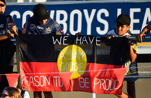 An Aboriginal flag showing support for AFL player Adam Goodes is seen displayed in the crowd before the start the round 21 NRL match between the North Queensland Cowboys and the Canberra Raiders.