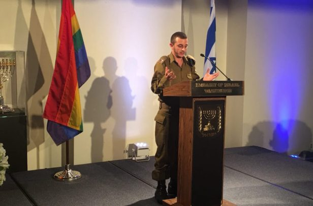 Transgender advocate and IDF lieutenant Shachar addressing the media