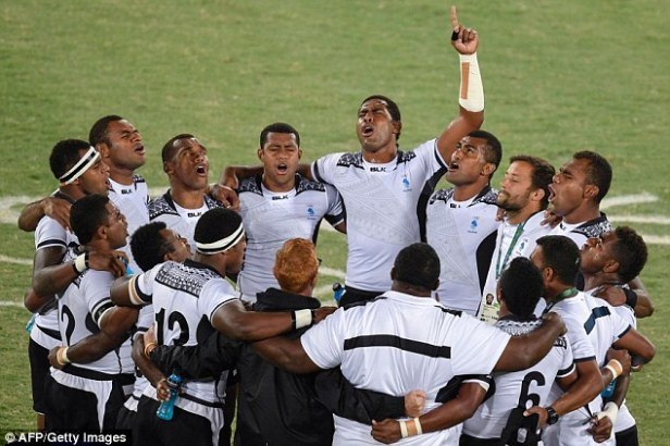The triumphant Fijians celebrate their countries first ever Olympic medal