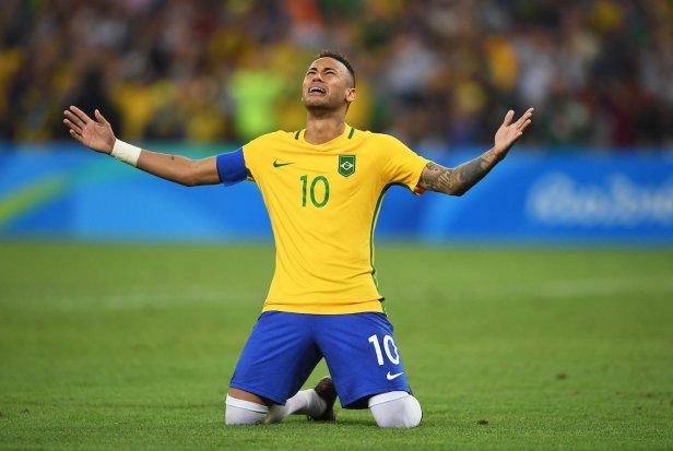 An emotioanl Neymar, after kicking the winning penalty for Brasil